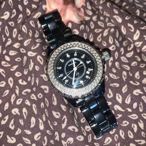 CHANEL Jewelry - J 12 automatic Chanel watch with diamonds.